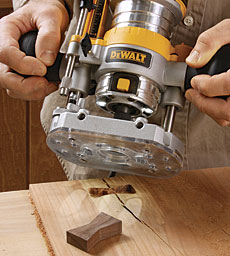 Dewalt dwp611pk router combo kit finewoodworking in fixed base mode left dewalts compact router can profile an edge one handed like a trim router in plunge mode right the tool becomes a precision greentooth