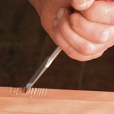 chop out waste with a chisel