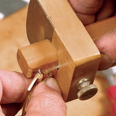Set the first marking gauge for the width of the hinge